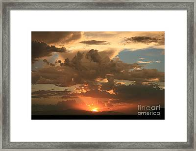 Cloudy Orange Sunset Framed Print by Cassandra Lemon