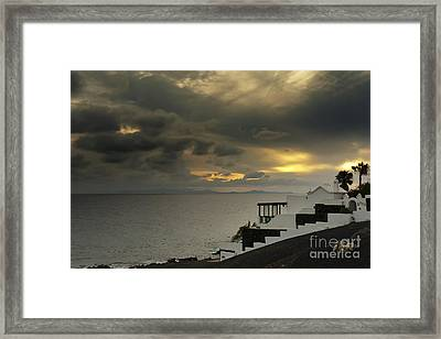 Cloudy Sunset Framed Print by Roberto Bettacchi