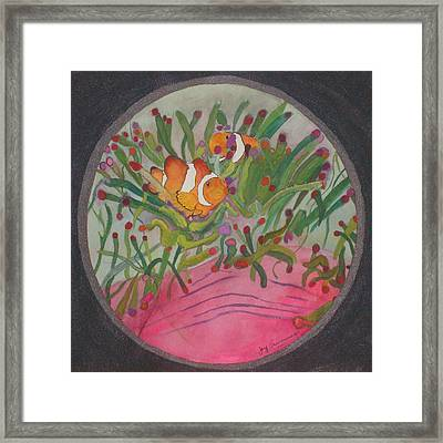 Clownfish Seen Through A Lense Framed Print