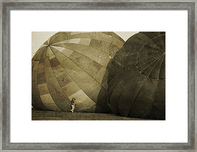 Coaxing The Balloons Framed Print by Betsy Knapp