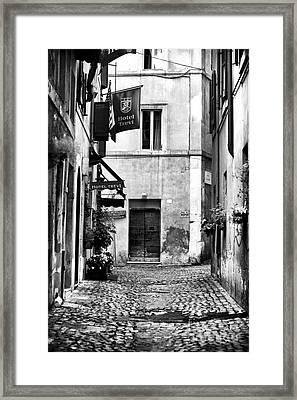 Cobblestone In Rome Framed Print by John Rizzuto