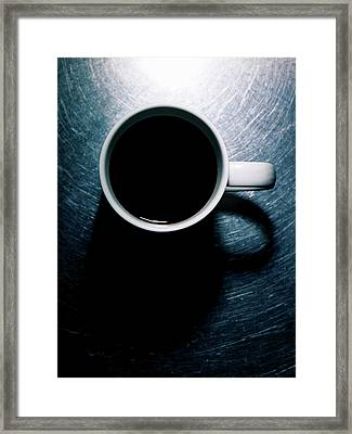 Coffee Cup On Stainless Steel. Framed Print by Ballyscanlon