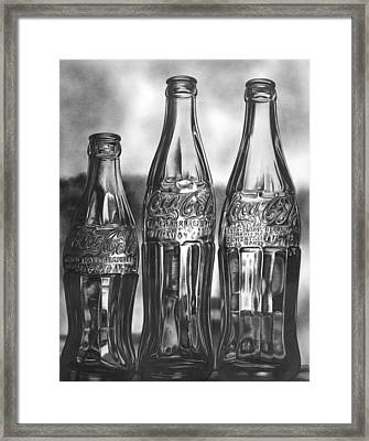 Coke Bottles Framed Print by Jerry Winick