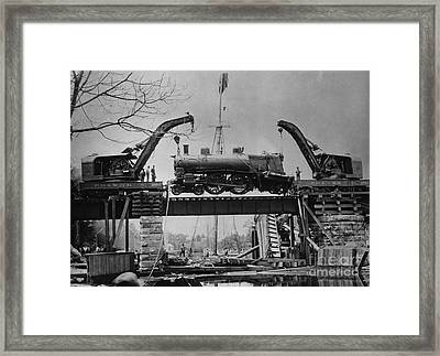 Collapsed Bridge And Train Recovery Framed Print by M E Warren and Photo Researchers
