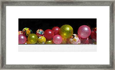 Colorful Balls In The Shop Window Framed Print