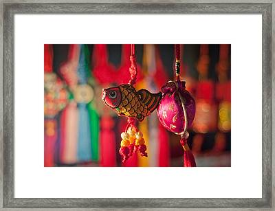 Colorful Fabric Fish And Sachet Framed Print by Eastphoto
