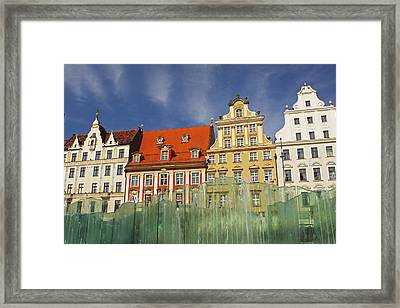 Colourful Buildings And Fountain Framed Print