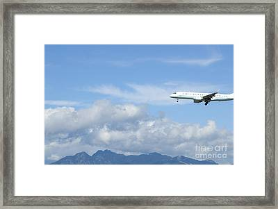 Commercial Airliner Coming In For A Landing Framed Print by Marlene Ford