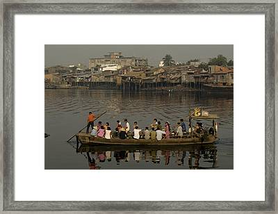 Commuters Cross A River In Saigon Framed Print by Paul Chesley