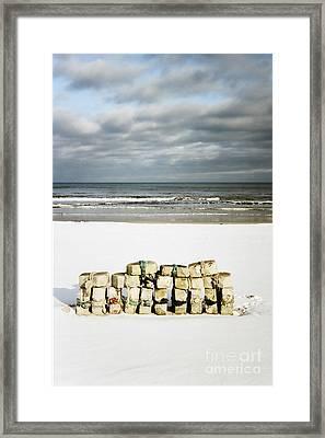 Framed Print featuring the photograph Concrete Bricks On A Snowy Beach by Agnieszka Kubica