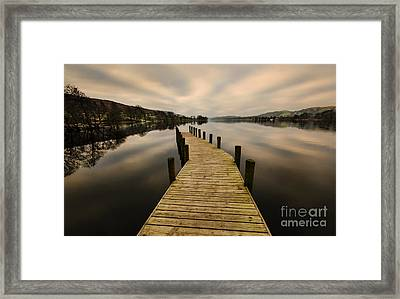 Coniston Water Jetty Framed Print by John D Hare