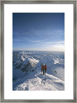 Conrad Anker Summits A Mountain Framed Print by Jimmy Chin