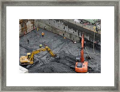 Construction Site Diggers And Workmen In The Foundation Pit Of A New Building Seattle Framed Print by Andy Smy