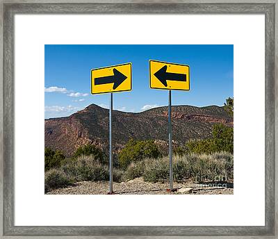 Contradictory Road Signs Framed Print