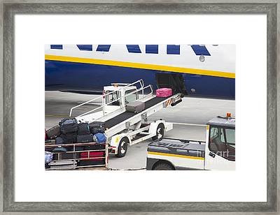 Conveyor Unloading Luggage Framed Print by Jaak Nilson