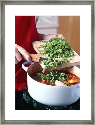 Cooking A Casserole Framed Print by Veronique Leplat