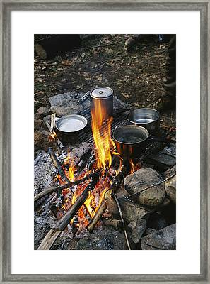 Cooking Over A Campfire On The Middle Framed Print