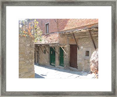 Cortona Doorways Framed Print by Brenda Berlin