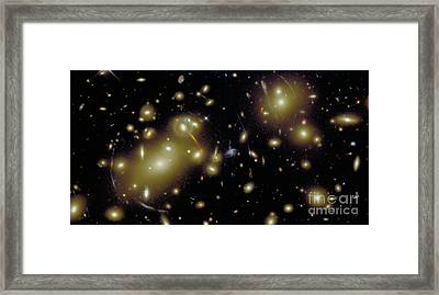 Cosmic Magnifying Glass Framed Print by STScI/NASA/Science Source