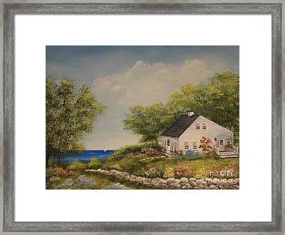 Cottage By The Lake Framed Print
