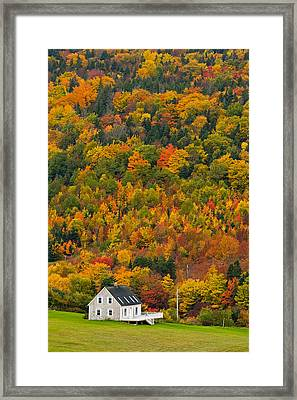 Cottage In Front Of Autumn Colours Framed Print
