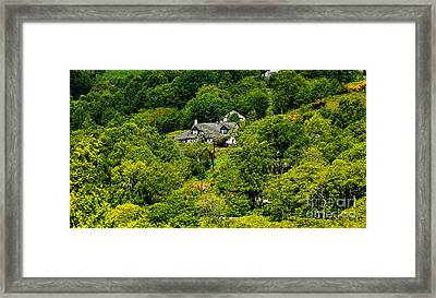 Cottage In The Woods Framed Print by Pravine Chester