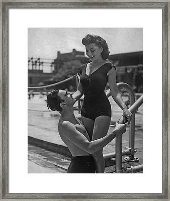 Couple At The Pool Framed Print by Fpg