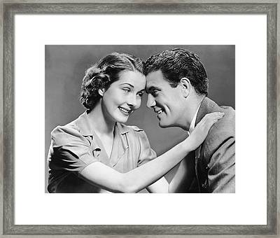 Couple Being Romantic Framed Print by George Marks