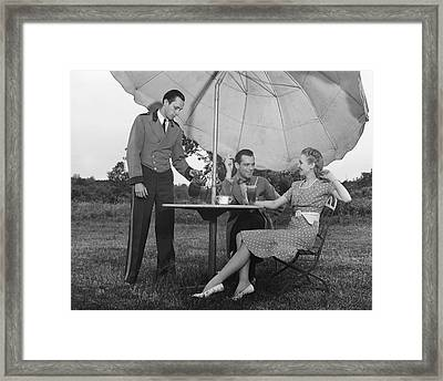 Couple Being Served By Waiter Framed Print by George Marks
