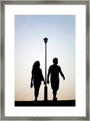 Couple Exercise While Walking At Sunset Framed Print by Virginia Star