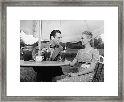 Couple Having Ice Tea Outdoors, (b&w) Framed Print by George Marks
