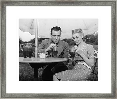 Couple Having Ice Tea Outdoors, (b&w), Portrait Framed Print by George Marks