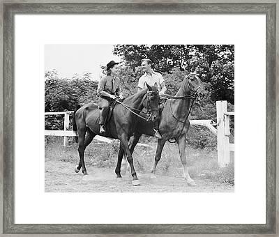 Couple Horseback Riding Framed Print by George Marks