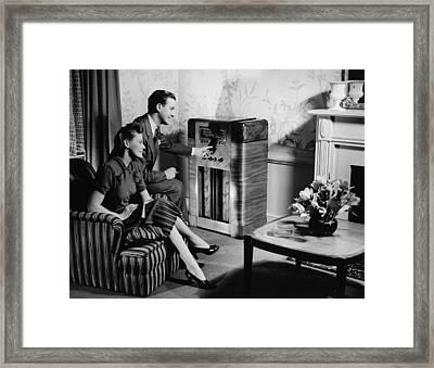Couple Listening To Radio In Living Room, (b&w) Framed Print by George Marks
