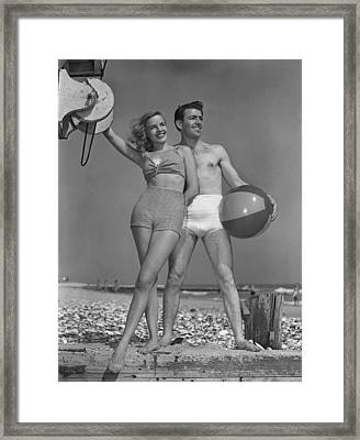 Couple On Beach W/beach Ball Framed Print by George Marks