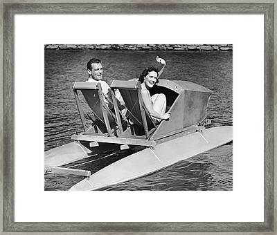 Couple On Lake In Paddle Boat Framed Print by George Marks