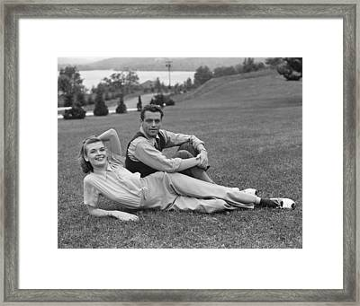 Couple On Lawn Framed Print by George Marks