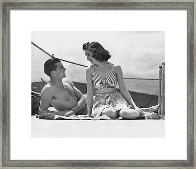 Couple Relaxing On A Sailboat Framed Print by George Marks