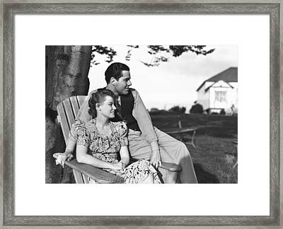 Couple Relaxing On Deckchair In Garden, (b&w) Framed Print by George Marks