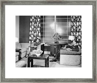 Couple Sitting In Living Room Reading Framed Print by George Marks