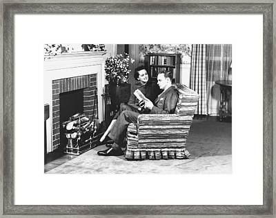 Couple Sitting On Armchair In Front Of Fireplace, (b&w) Framed Print by George Marks