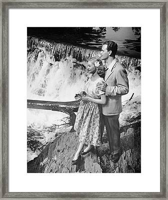 Couple Standing Near Waterfall Framed Print by George Marks