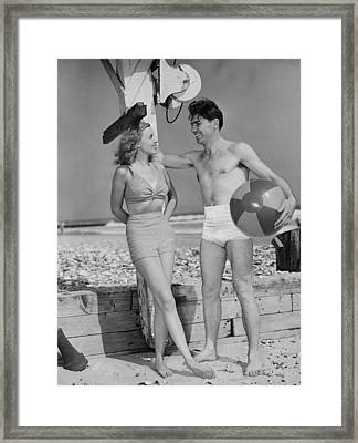 Couple Standing On Beach, Talking, (b&w) Framed Print by George Marks