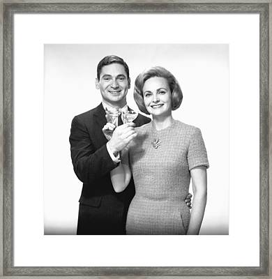 Couple Toasting Champagne In Studio, (b&w),, Portrait Framed Print by George Marks