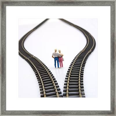 Couple Two Figurines Between Two Tracks Leading Into Different Directions Symbolic Image For Making Decisions Framed Print