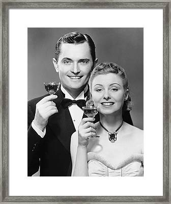 Couple W/ Champagne Glasses Framed Print by George Marks