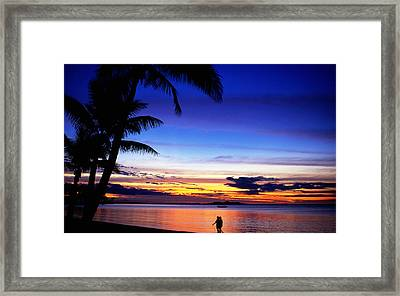 Couple Walking Along Beach At Sunset, Fiji Framed Print by Peter Hendrie