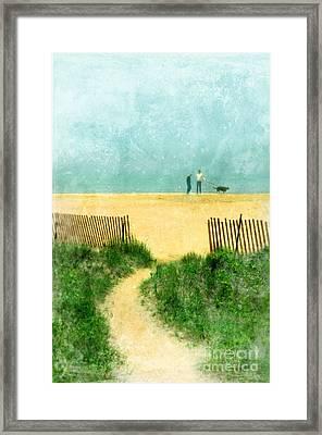 Couple Walking Dog On Beach Framed Print by Jill Battaglia
