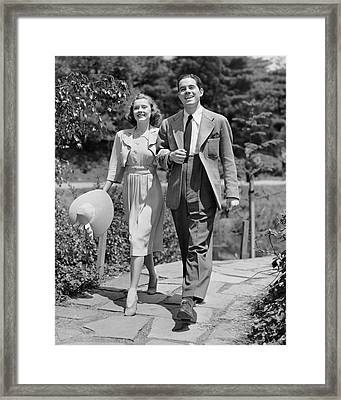 Couple Walking Together Outdoors Framed Print by George Marks