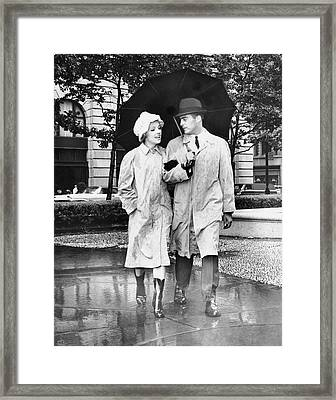 Couple W/umbrella Walking In The Rain Framed Print by George Marks